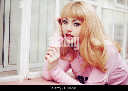 Young romantic themed woman in urban area - Stock Photo