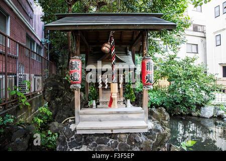 Muchinoike and Tsunokamibenzaiten,Arakicho Street,Shinjuku-Ku,Tokyo,Japan near Yotsuyasanchome Station - Stock Photo