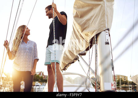Couple Bought A Boat, Looking at each Other Satisfied - Stock Photo