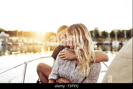 Loving Couple Enjoying Life Sitting outside in on a Summer Evening - Stock Photo