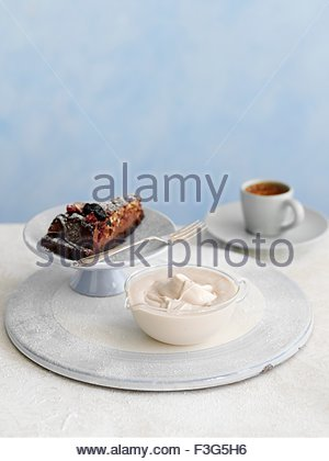 White chocolate creme, chocolate cake and a cup of coffee - Stock Photo