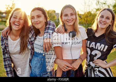 Group of teenage girls hanging out on a summer evening - Stock Photo