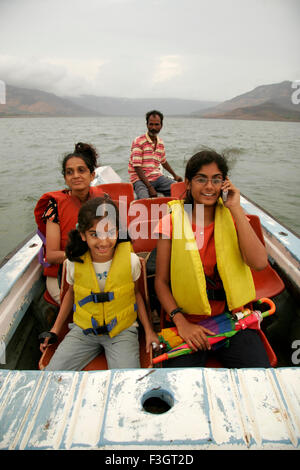 Women And Teenagers Wearing Life Jackets Paddling And