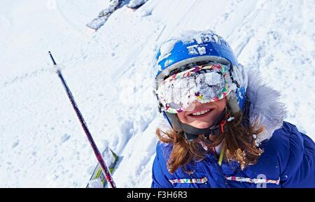Girl with snow-covered ski goggles, Chamonix, France - Stock Photo