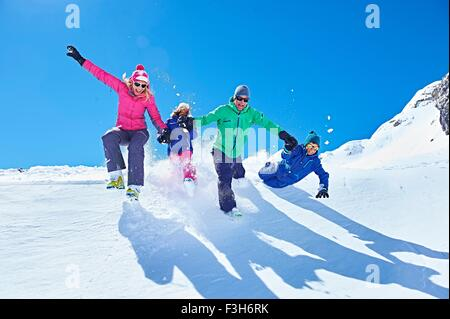 Family playing in snow, Chamonix, France - Stock Photo