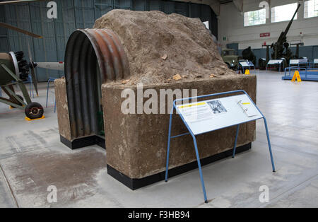 CAMBRIDGESHIRE, UK - OCTOBER 5TH 2015: An Anderson Air Raid Shelter on display at the Imperial War Museum Duxford - Stock Photo