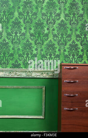 Living room with green vintage pattern. Rich retro vintage pattern on old wall - Stock Photo