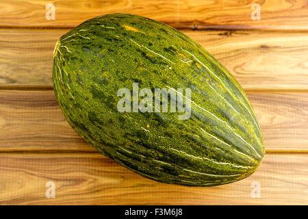 Gourmet studio shot of green santa claus sapo melon - Stock Photo
