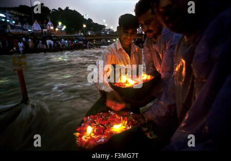 People offering a deepak (floating flowers and oil lamp) to the Ganges river. Haridwar. Uttarakhand. India. Haridwar, - Stock Photo