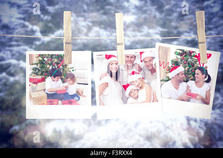 Composite image of happy brother and sister looking at christmas gifts - Stock Photo