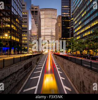 Car light trails in Park Avenue South, Midtown, Manhattan. Evening light on New York City skyscrapers and Grand - Stock Photo