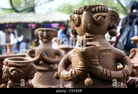 clay statue of woman in surajkund fair - Stock Photo
