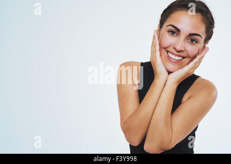 Beautiful woman with nice skin, smiling at camera holding her cheeks. Copy space. Isolated Portrait - Stock Photo