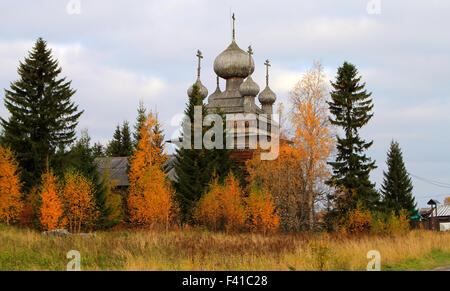 Ancient Russian Church in the autumn forest - Stock Photo