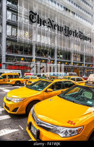 NEW YORK CITY - DEC 01 The New York Times building and characteristic Yellow Taxi Cab,on December 01th, 2013 in - Stock Photo