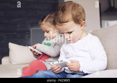 Children using smartphones - Stock Photo