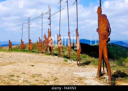 Sculptures dedicated to the pilgrims walking the Way of Saint James (Camino de Santiago) on Alto del Perdon, Gazolaz, - Stock Photo