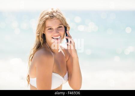 Happy pretty blonde having phone call - Stockfoto