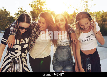 Group og teenage girls walking the streets and laughing - Stock Photo