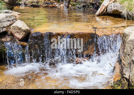 Small waterfall in a stream flowing through the countryside, Crowden Clough, Vale of Edale, Derbyshire, England, - Stock Photo