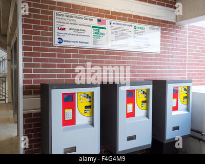 Multi-space pay stations inside the Metro-North North White Plains Station Parking Garage. - Stock Photo