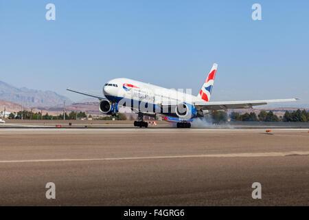 British Airways Boeing 777 landing on runway 25L at Las Vegas McCarran International Airport - Stock Photo