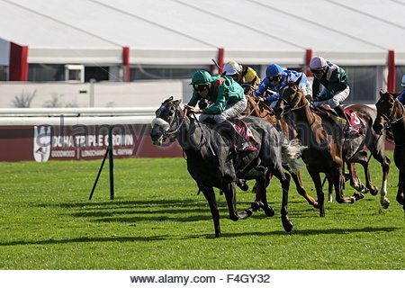 Paris, France. October 3rd, 2015. FRANCE, Paris: Jockeys get on horses during 94th Prix de l'Arc de Triomphe held - Stock Photo