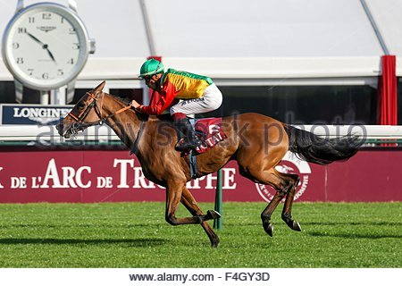Paris, France. October 3rd, 2015. FRANCE, Paris: A jockey gets on a horse during 94th Prix de l'Arc de Triomphe - Stock Photo