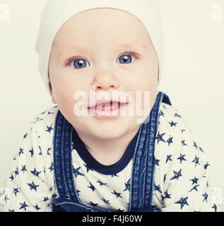little cute baby toddler on carpet isolated close up - Stock Photo