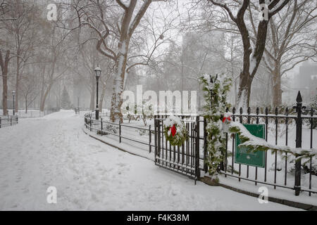 Madison Square Park covered with snow. Wintertime in the Flatiron District, Midtown Manhattan, New York City, USA - Stock Photo