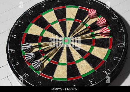 The darts isolated on white background - Stock Photo