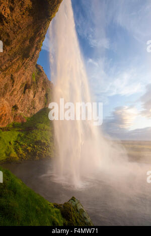 Seljalandsfoss waterfall plunging 60m from the cliff above, Sudhurland, Iceland. - Stock Photo