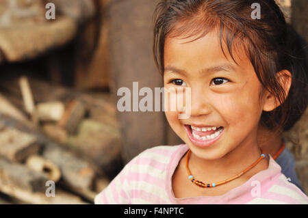 Nagaland, India - March 2012: Portrait of happy girl smiling, Nagaland, remote region of India. Documentary editorial. - Stock Photo