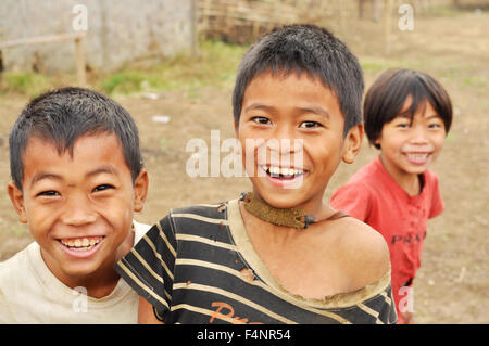 Nagaland, India - March 2012: Happy children smile at camera in Nagaland, remote region of India. Documentary editorial. - Stock Photo