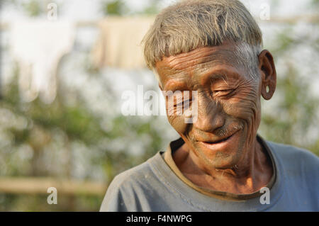Nagaland, India - March 2012: Portrait of old man with traditional painted face in Nagaland, remote region of India. - Stock Photo