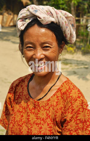 Nagaland, India - March 2012: Joyful woman smiles on camera in Nagaland, remote region of India. Documentary editorial. - Stock Photo
