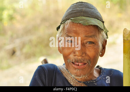 Nagaland, India - March 2012: Old man smiles at camera in Nagaland, remote region of India. Documentary editorial. - Stock Photo