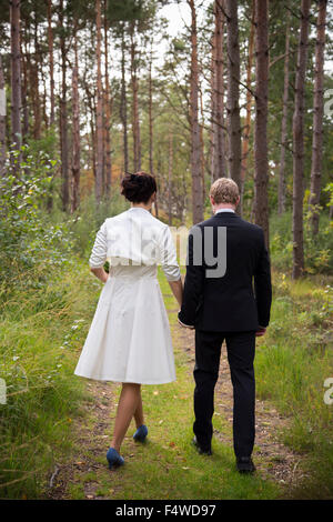 Sweden, Swedish West Coast, Bohuslan, Newly wed couple in forest - Stock Photo