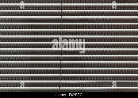 shut slatted closed modern venetian or roman blind from several thin metal slats - Stock Photo