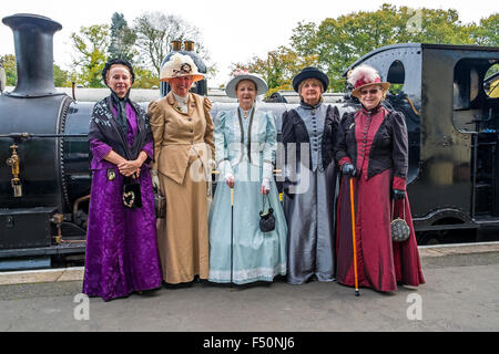 A group of ladies in Victorian dress on the platform at the Bodmin & Wenford steam railway - Stock Photo