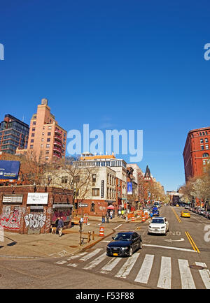 NEW YORK, USA - MAY 07, 2015: View of sunny New York City street with brown brick buildings and speeding cars. Manhattan, - Stock Photo