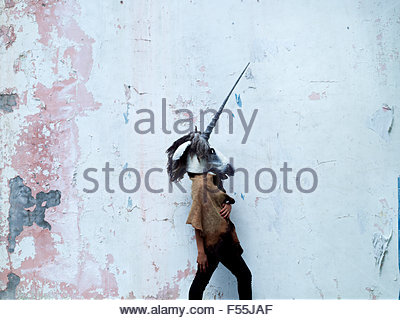 A model wearing a unicorn/horse mask. These masks are often worn for theatre and fashion productions. - Stock Photo