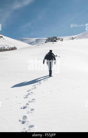 Man walking on the snow Faraya Kesrwan Lebanon Middle East - Stock Photo