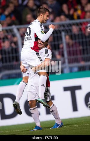 Cologne, Germany. 28th Oct, 2015. Leverkusen's goal-scorer Wladlen Jurtschenko (L) and Giulio Donati celebrate after - Stock Photo