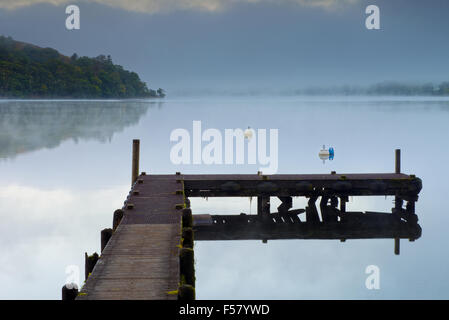 A Jetty stands on Ullswater Lake at Howtown at sunrise in the Lake District National Park, Cumbria, England, Uk, - Stock Photo