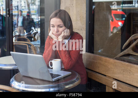 envy concept, bored sad woman in front of computer - Stock Photo
