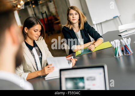 Beautiful businesswoman working in office and smiling - Stock Photo