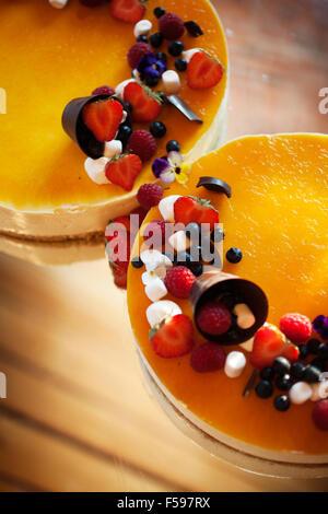 Wedding cheese cake with fresh berries and chocolate - Stock Photo