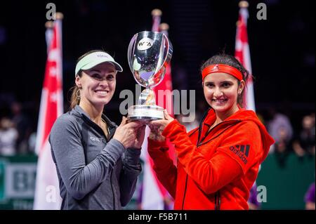 Martina Hingis / Sania Mirza celebrate after winning the double final of BNP Paribas WTA Finals Singapore 2015 at - Stock Photo