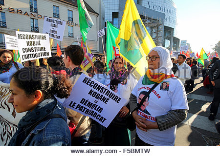 Paris, France. novembre 1st, 2015. FRANCE, Paris: A woman holds a banner reading Rebuild Kobane = demolish the patriarchy - Stock Photo